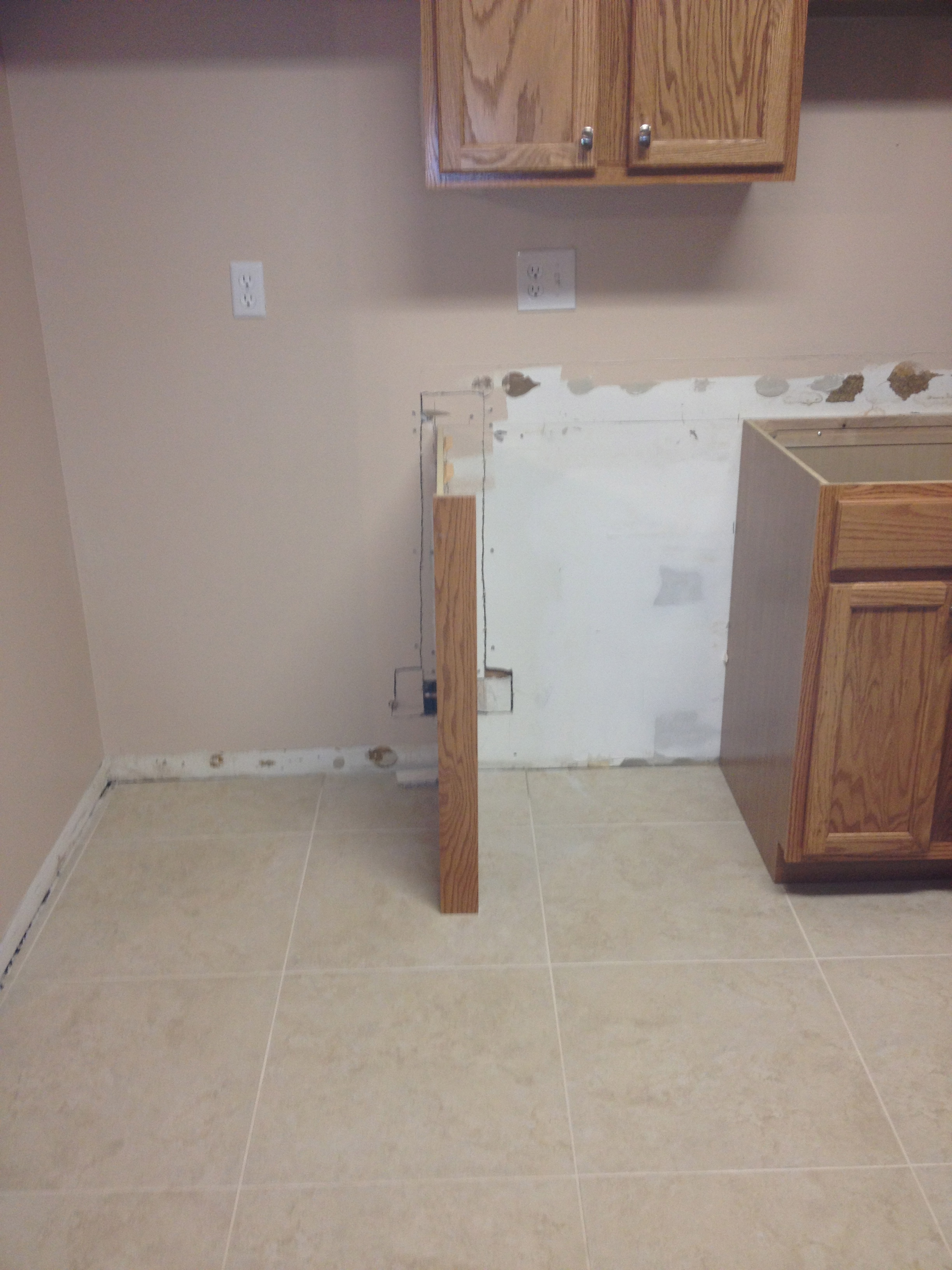 new tile flooring installed in the kitchen | code red restoration