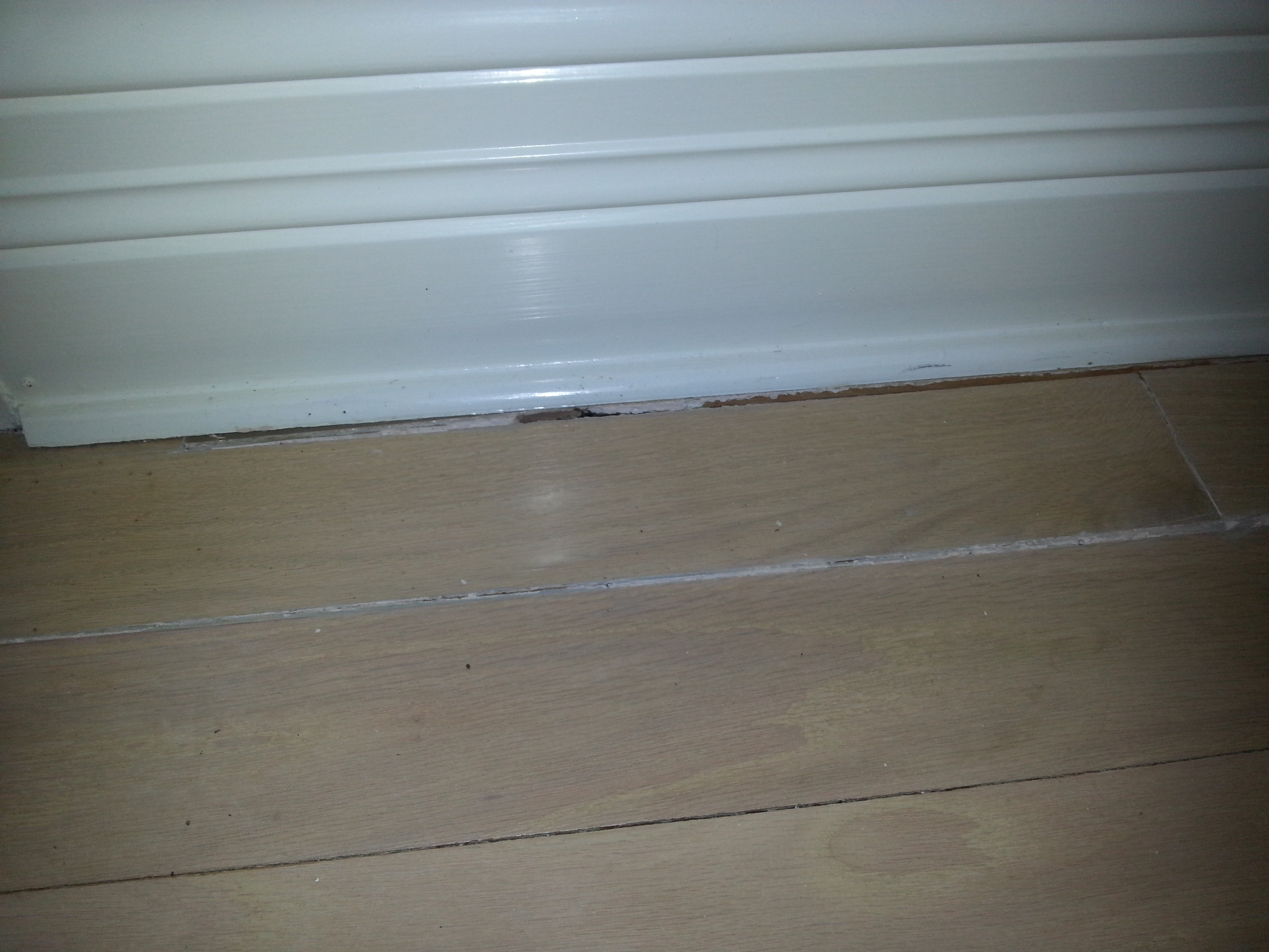 Water damaged wood flooring code red restoration llc water damage restoration fire damage for Water damage baseboard bathroom